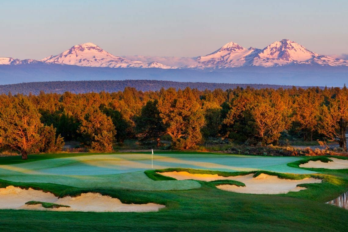 Setting sun casts pink light on Pronghorn Resort and nearby mountains