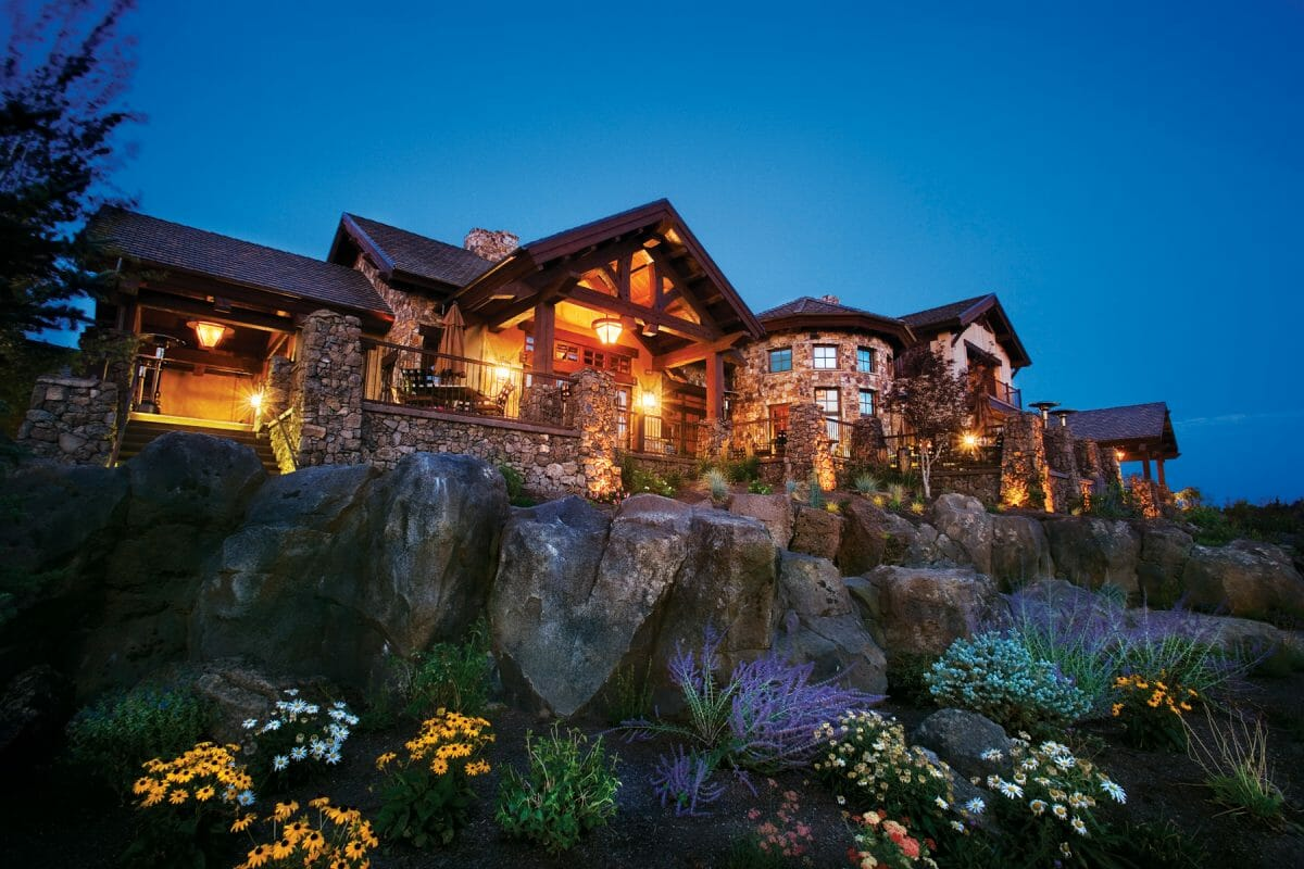 Pronghorn Resort clubhouse lit up at twilight in Oregon