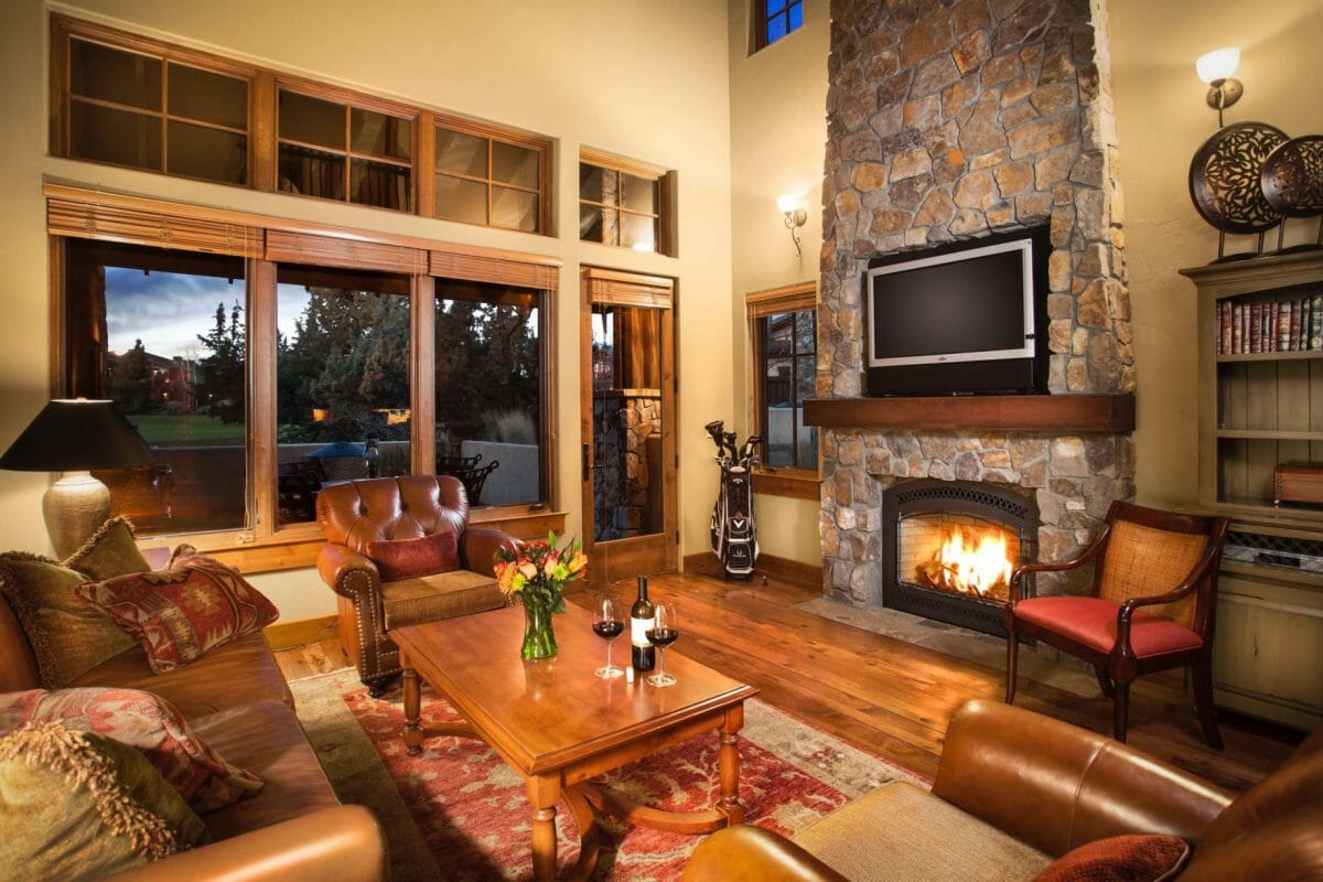 A large open living room with fire place at Pronghorn Resort