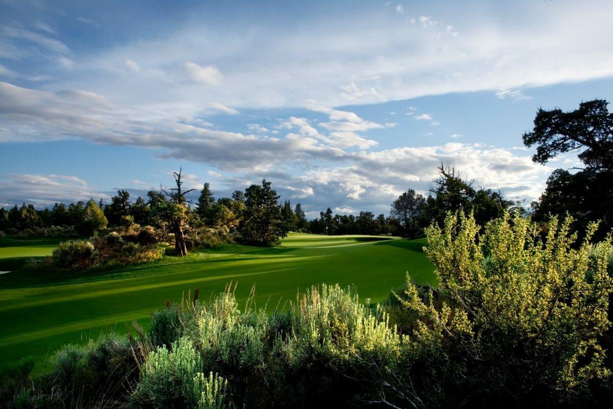 Green fairway lined by Oregon desert cactus at Pronghorn Resort