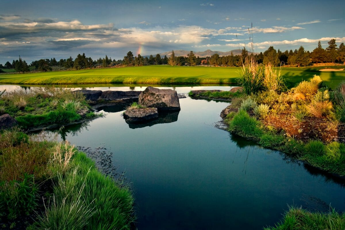 A lake stands on the Nicklaus course at Pronghorn Resort