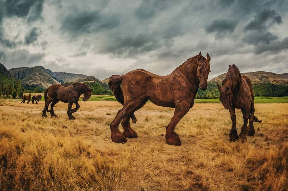 Iron horse sculptures line a fairway