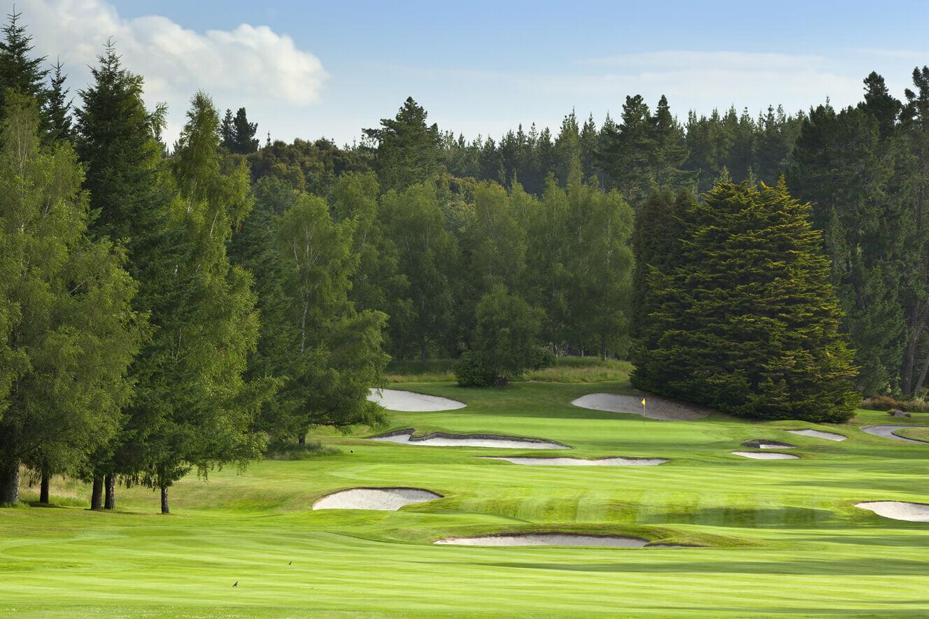 Par four golf hole looking toward the green