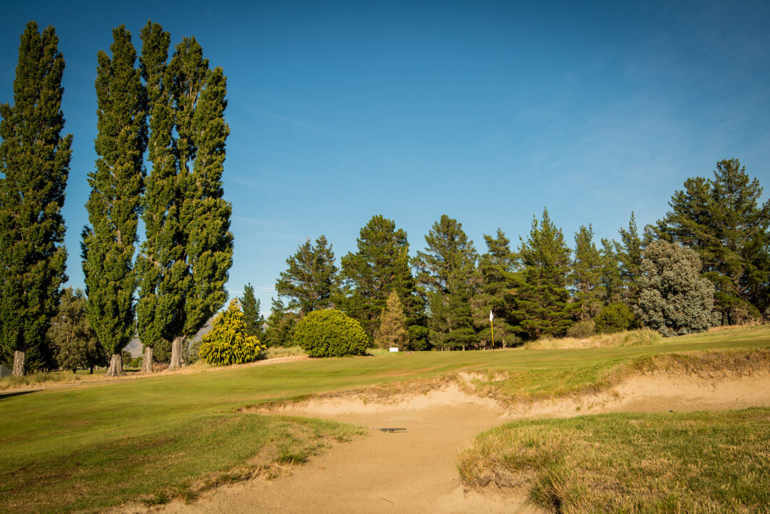 Large bunker leads to raised green
