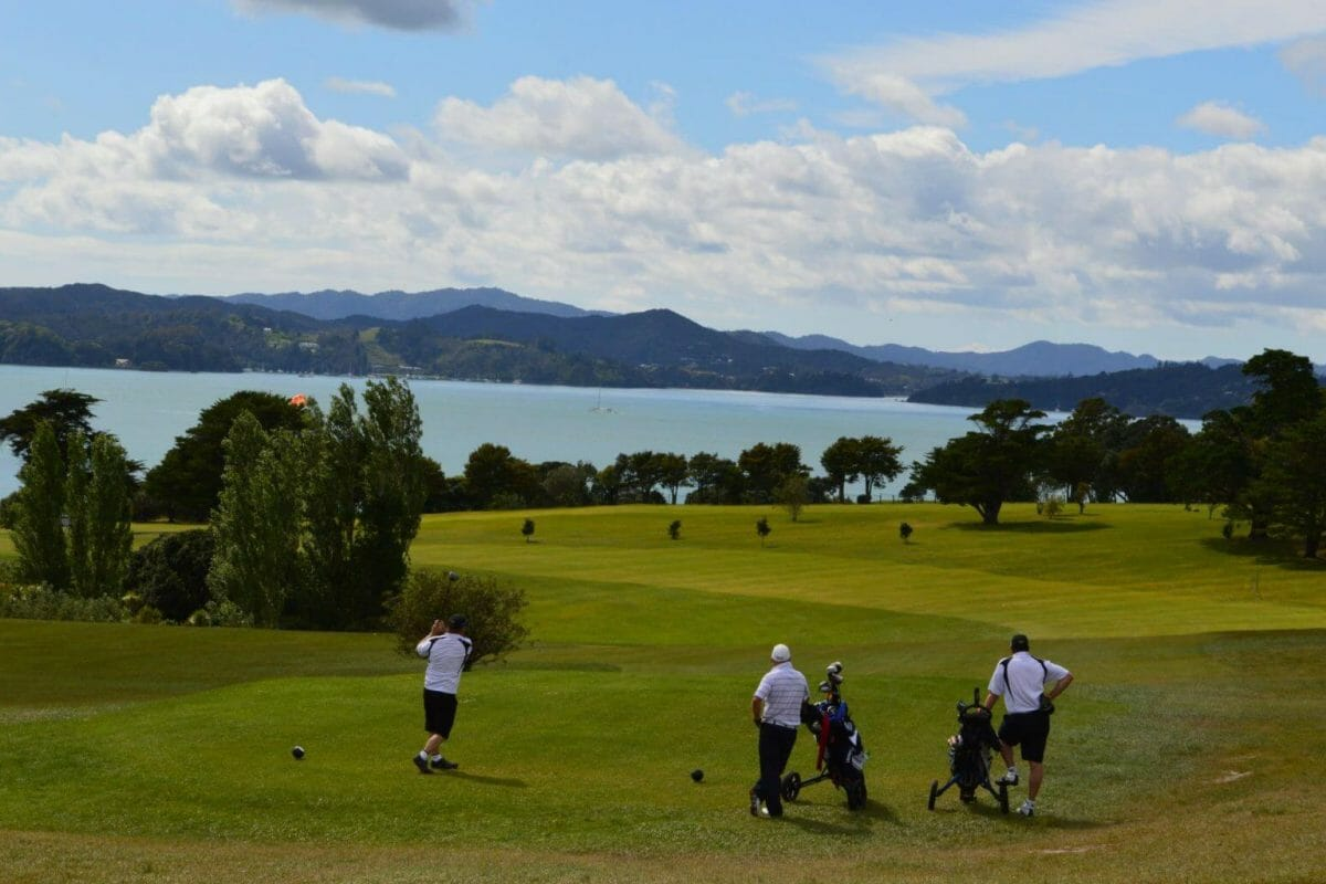 Golfers tee off on the eleventh hole of Waitangi Golf Course