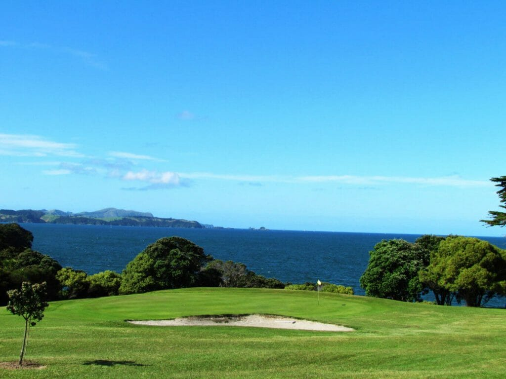 Par-three golf hole overlooks the Bay of Islands in New Zealand