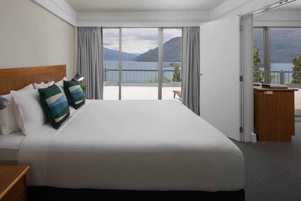 Double bed in a junior suite overlooking Lake Wakatipu