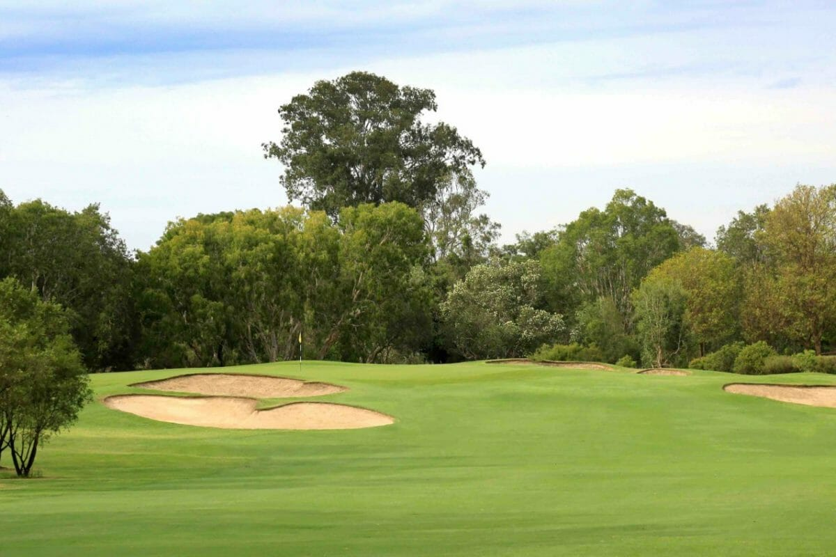 Flat fairway leads to raised green protected by bunkers