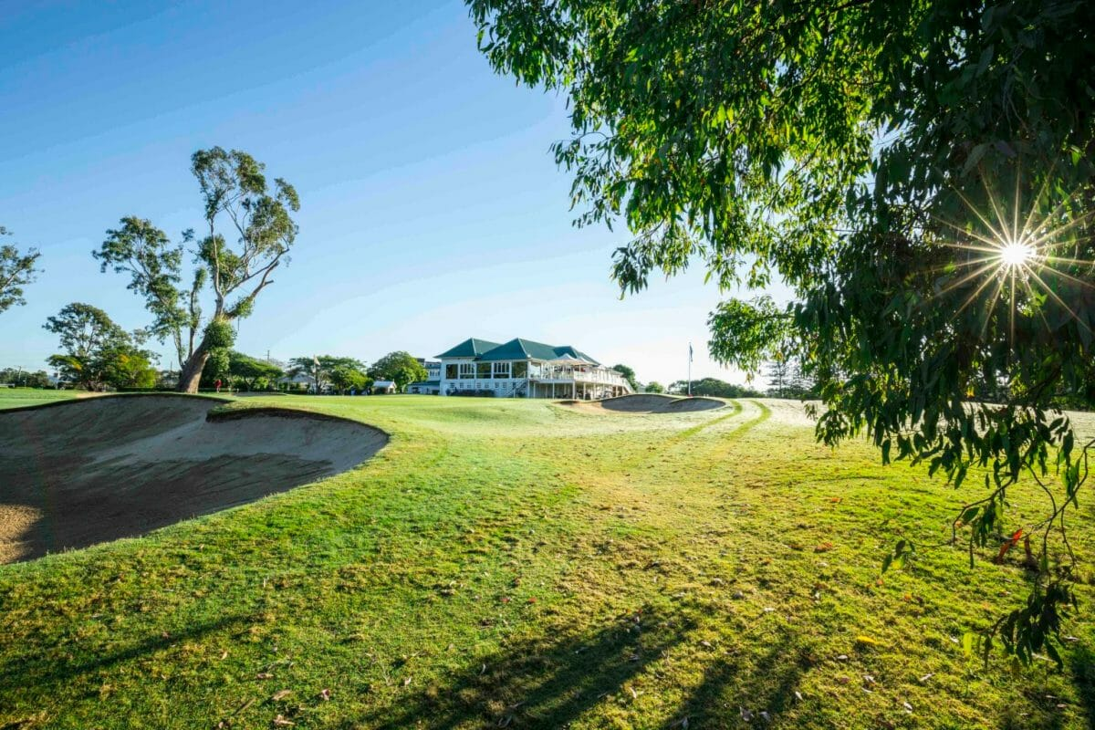 Golf clubhouse under morning sun and frost