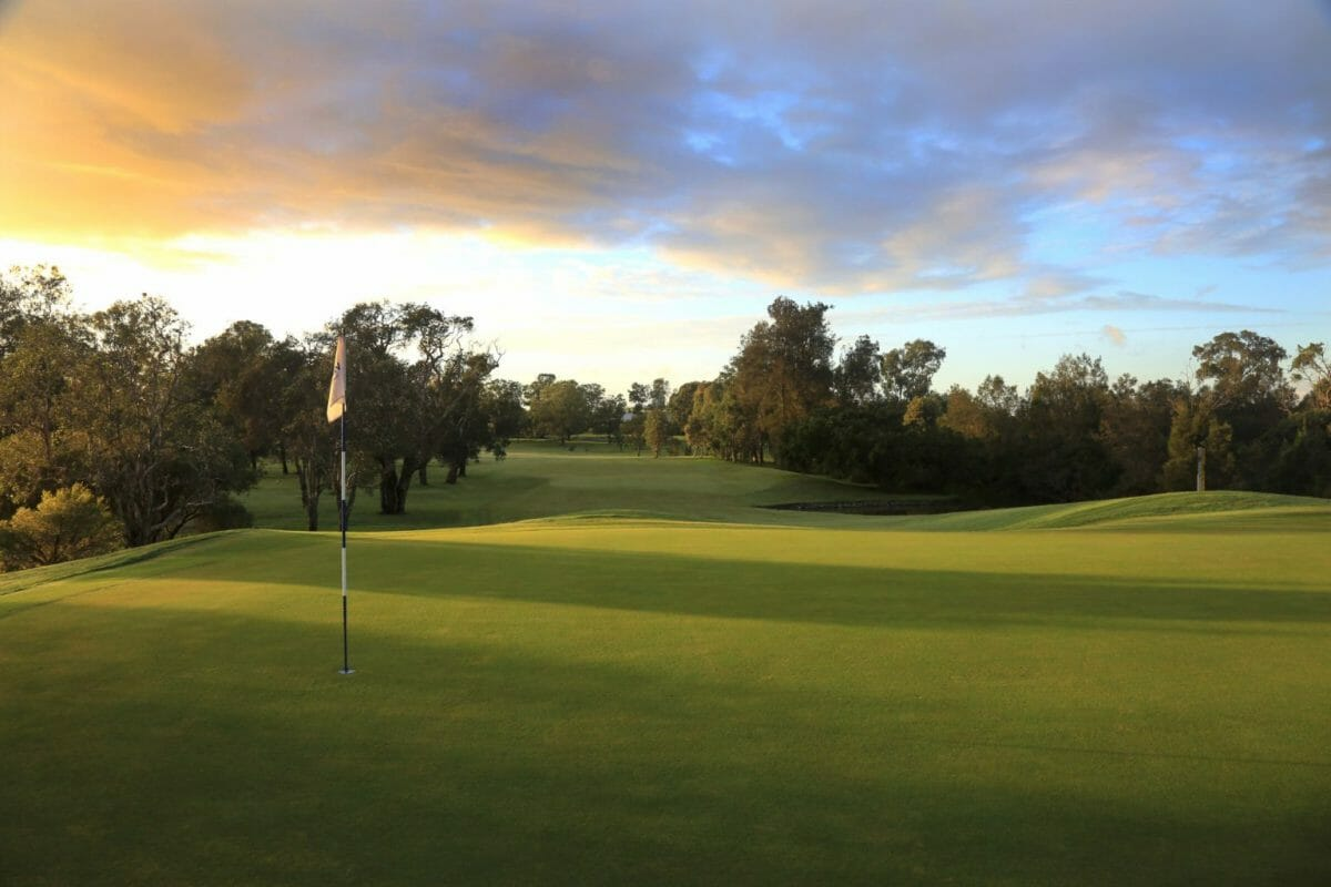 Yellow flag pin in Brisbane golf course green