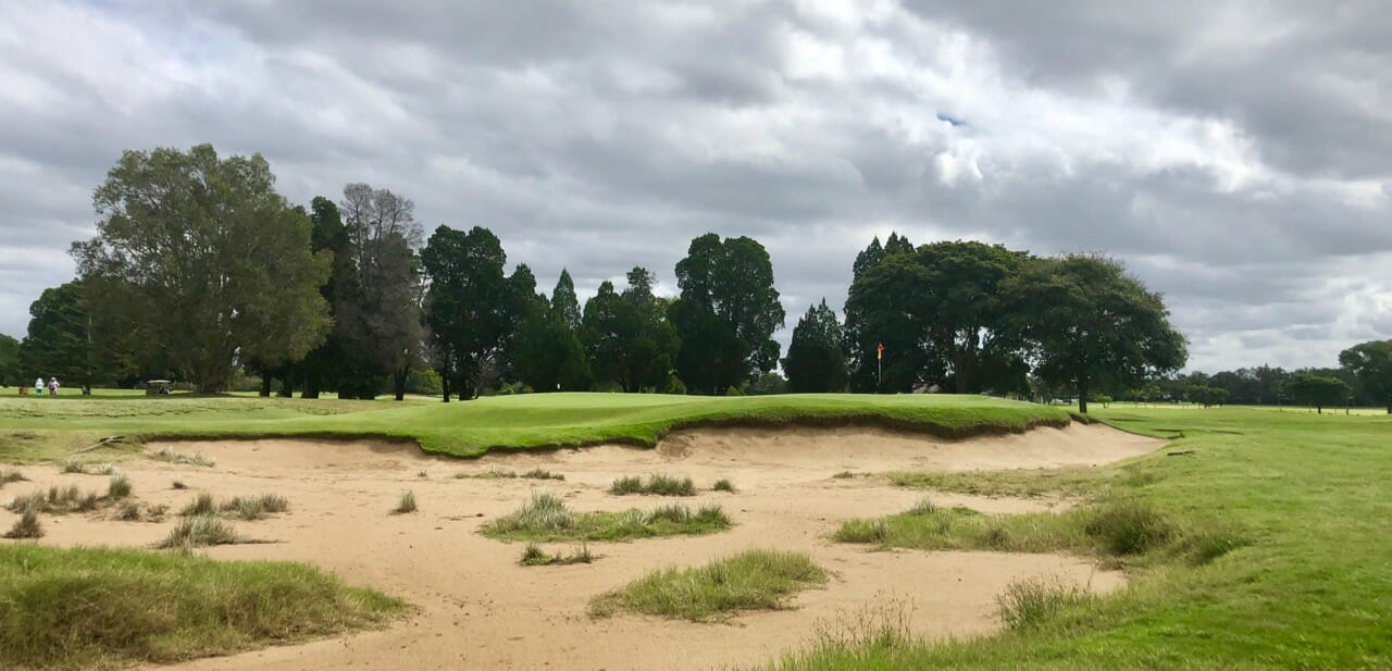 Bunkers frame the raised seventeenth green