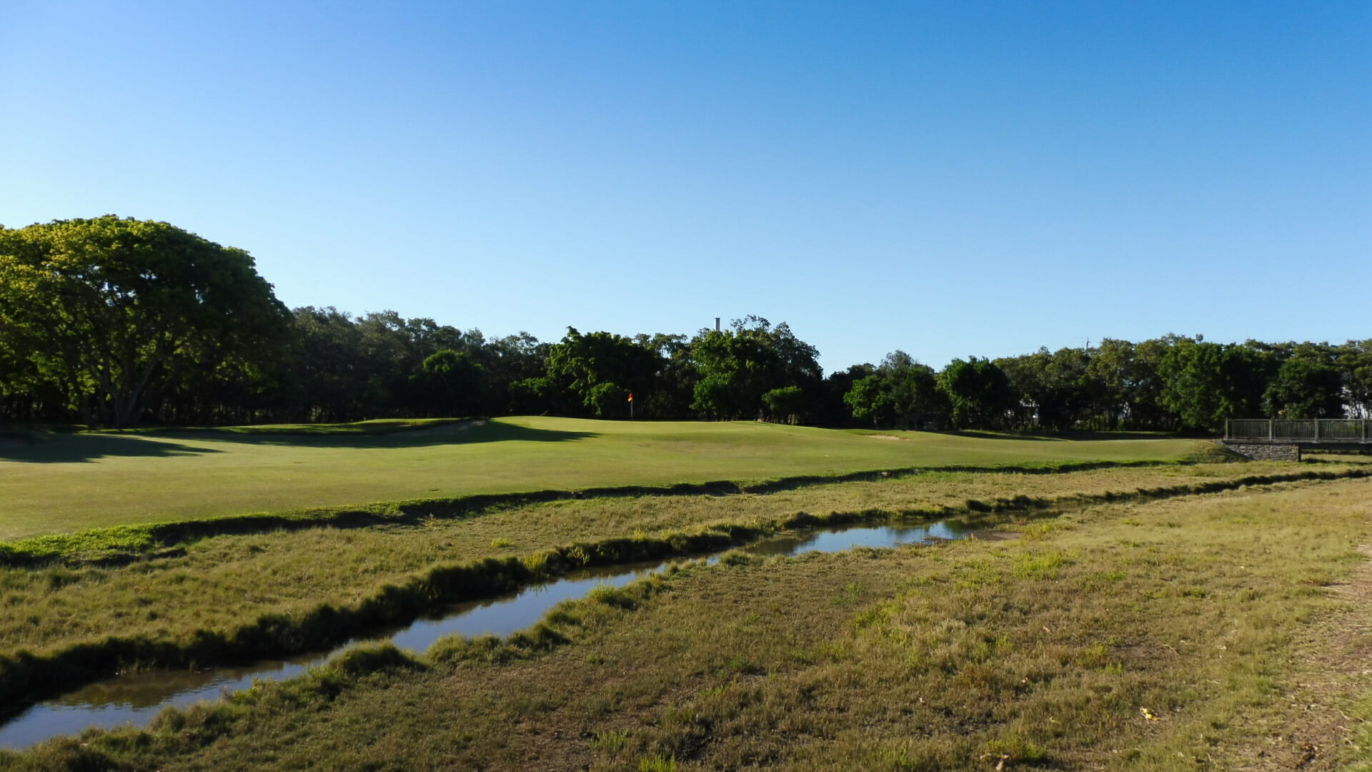 Natural waterway meanders through golf hole at Royal Queensland golf course