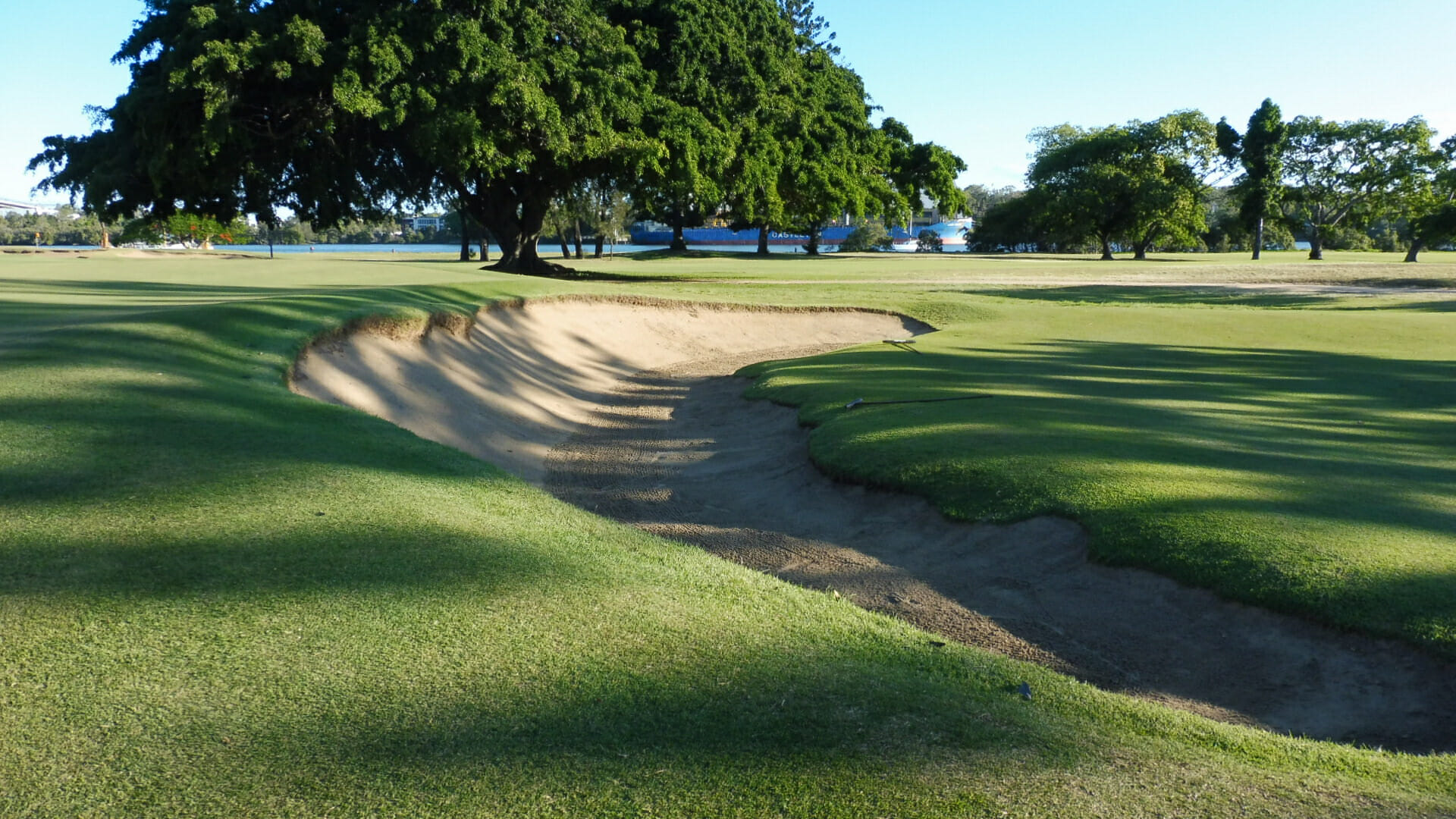 Large bunker frames the tenth green at Royal Queensland