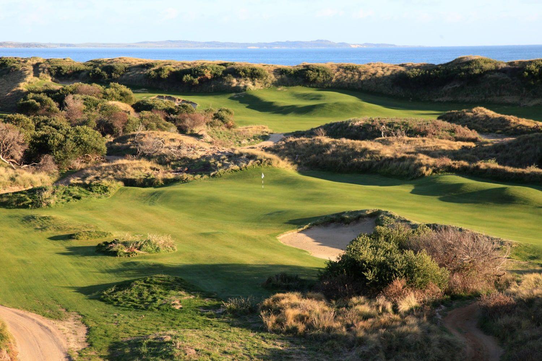 Undulating links golf course amid large sand dunes