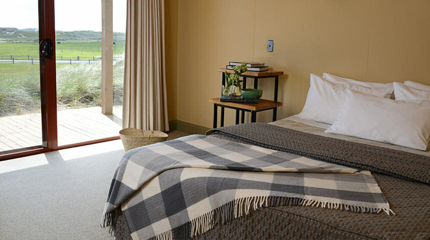 Comfortable bed in a Barnbougle cottage