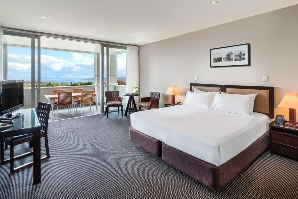 Large king bedroom opens unto a balcony overlooking Lake Taupo