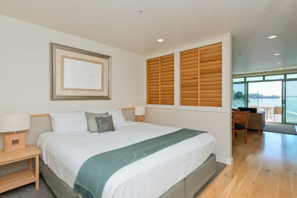 Hardwood floor and partitioned bed at Paihia Resort