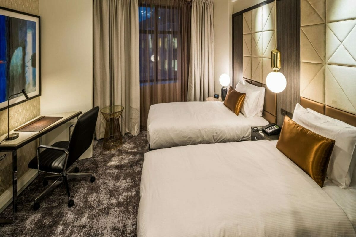 Twin beds in luxuriously-appointed bedroom at DoubleTree Hiilton