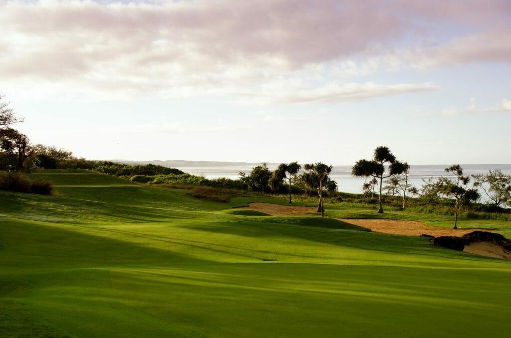 Sunset casts long shadows over Natadola Bay golf course
