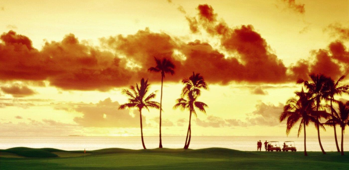 Sunset casting golden light over Denarau golf course