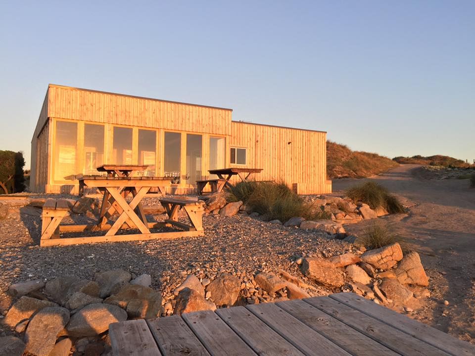 Ocean Dunes golf clubhouse at sunset