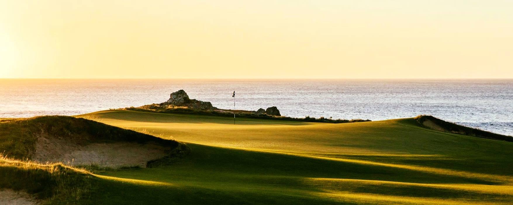 Ocean dunes golf hole framed by the sea