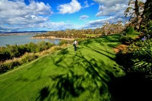 Golfer teeing off at Tasmania Golf course