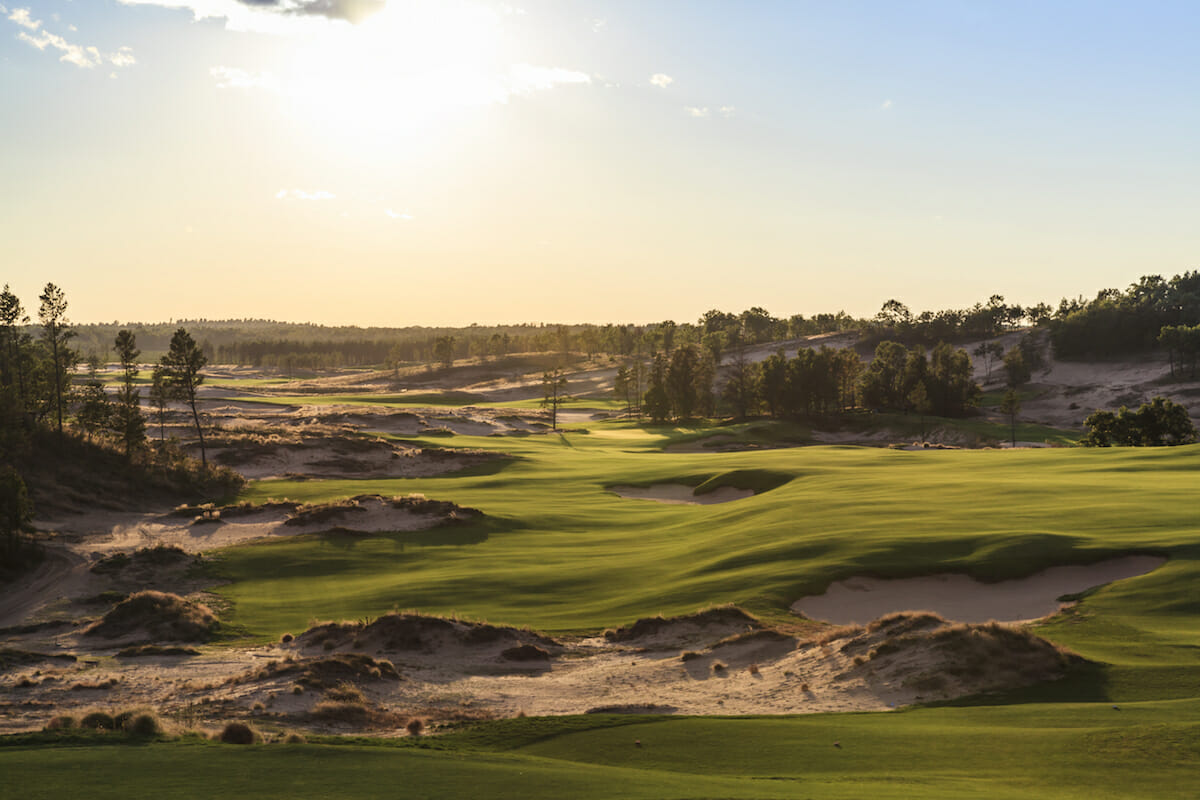 Setting sun over the tenth hole at Sand Valley golf course