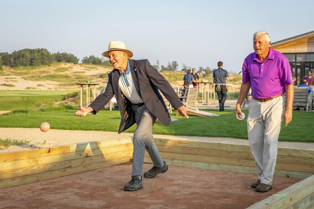 Partygoers play bocce at Sand Valley