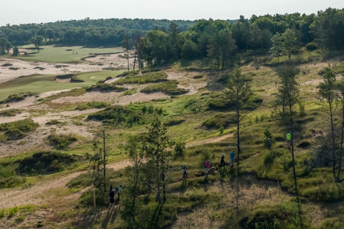 Hikers on trails at Sand Valley Resort