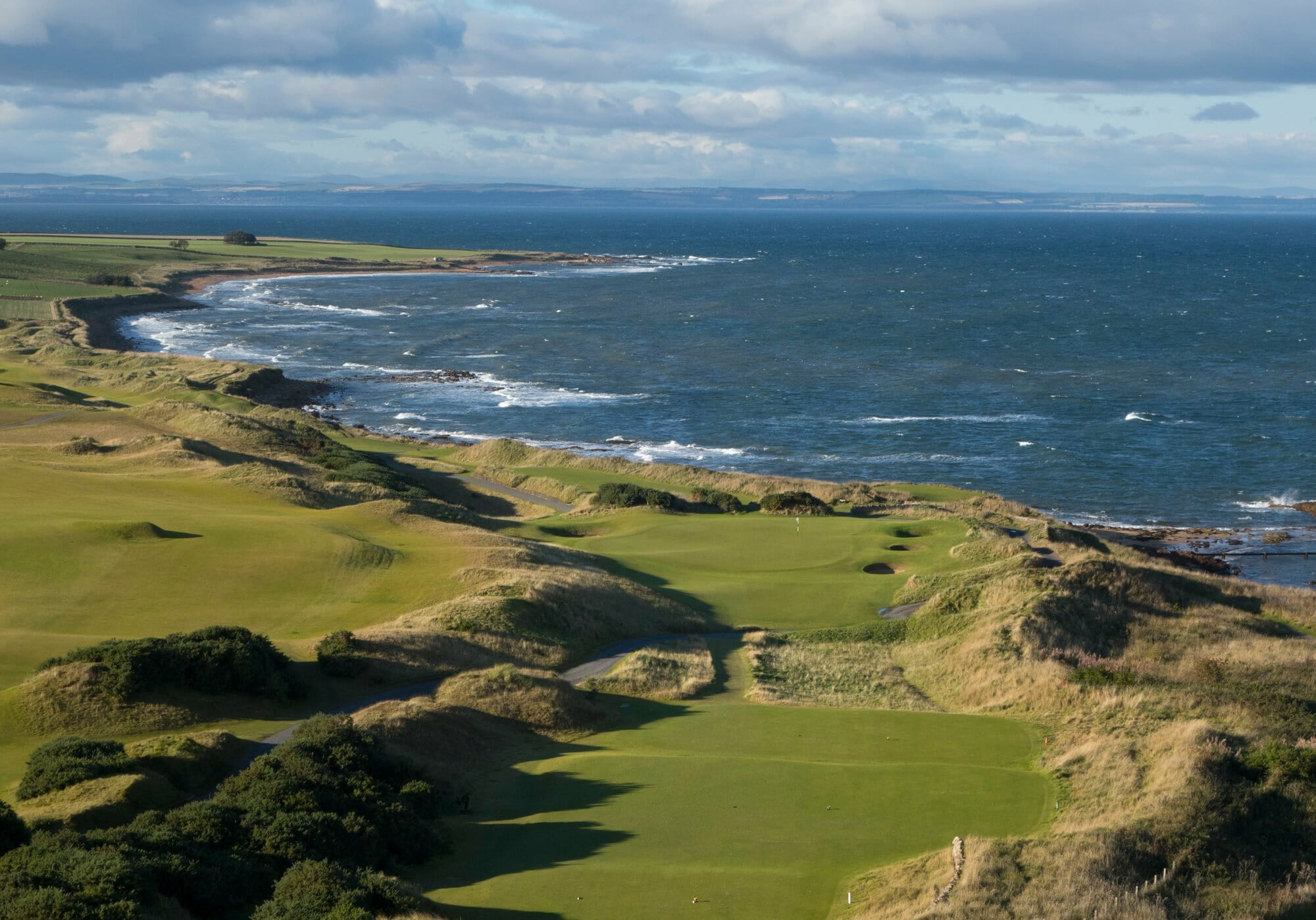 Looking down the hill of a par three at Kingsbarns Golf Links, Scotland, United Kingdom