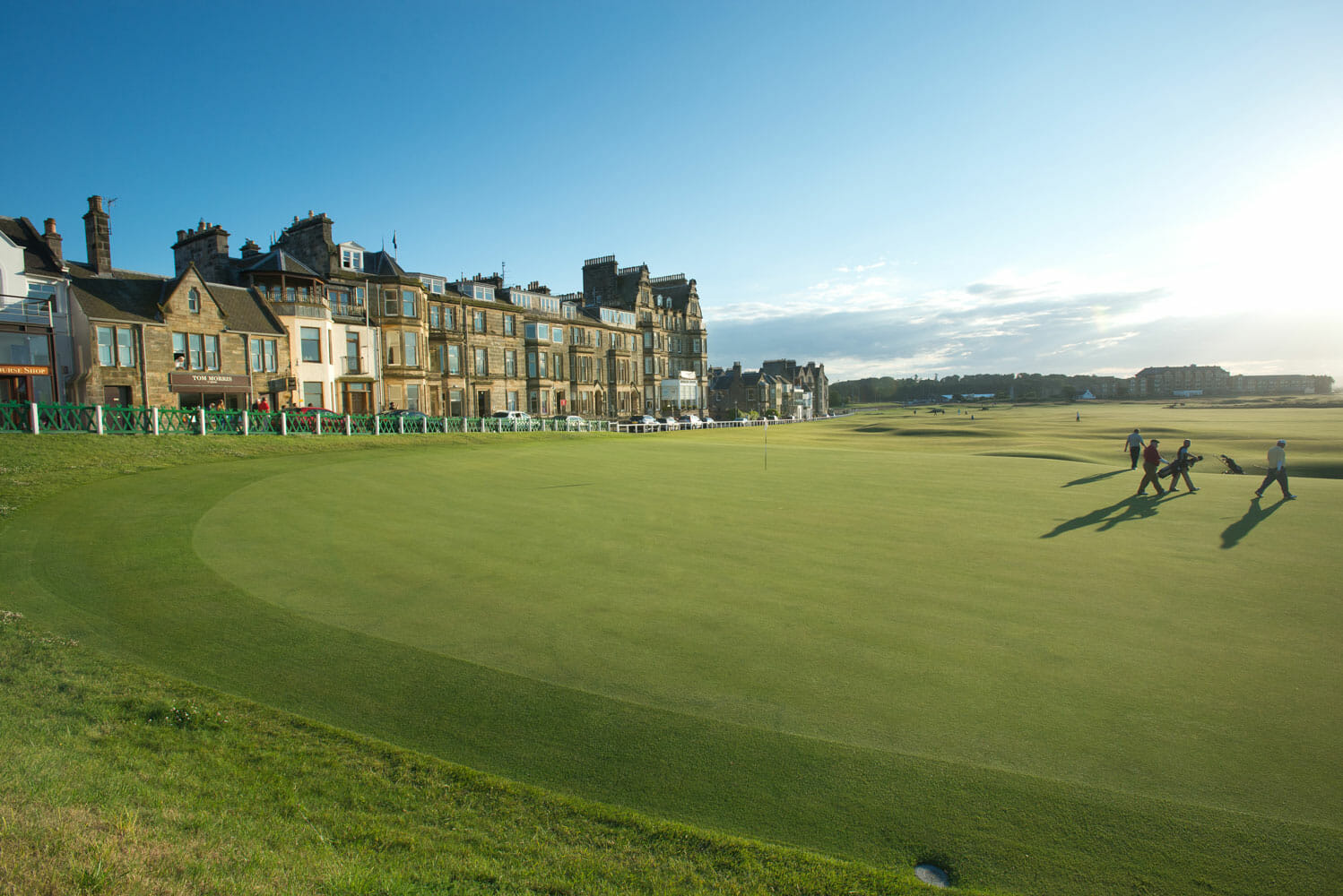 Golfers finish a round at St Andrews Links, Scotland