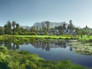 Lake, Montagu Course and resort buildings at Fancourt Resort, The Garden Route, South Africa