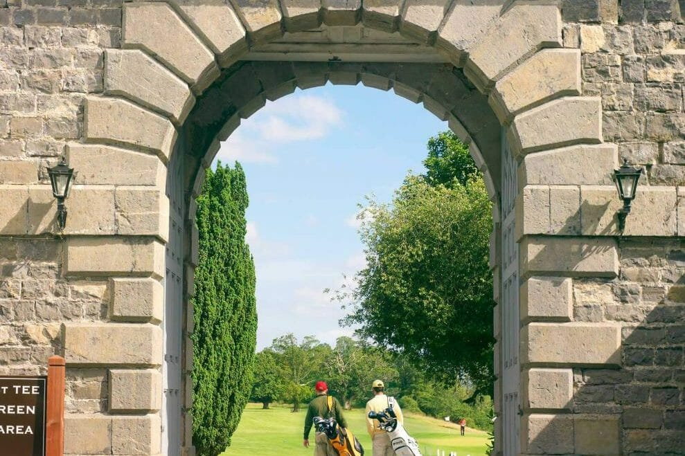 A dramatic archway stands over the entrance to golf, Carton House, Ireland