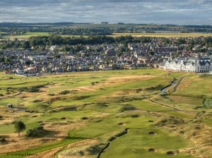 Aerial view of the town contrasted with Carnoustie Golf Links, Scotland, United Kingdom