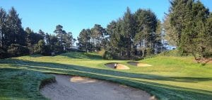 Image displaying a golfer in a bunker on the Salishan Golf Course, Oregon, USA