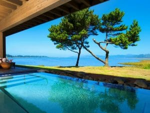 Image depicting a private pool and bright blue skies, Salishan Resort, Oregon, USA