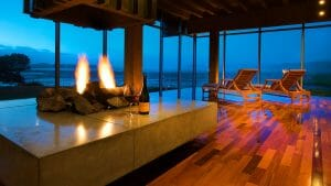 Image of a cost fire and bottle of red wine for two, Salishan Resort, Oregon, USA