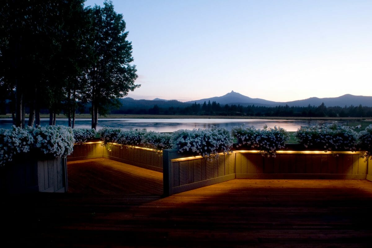 Twilight image of The Lodge Deck and distant mountains at Black Butte Ranch, Oregon, USA