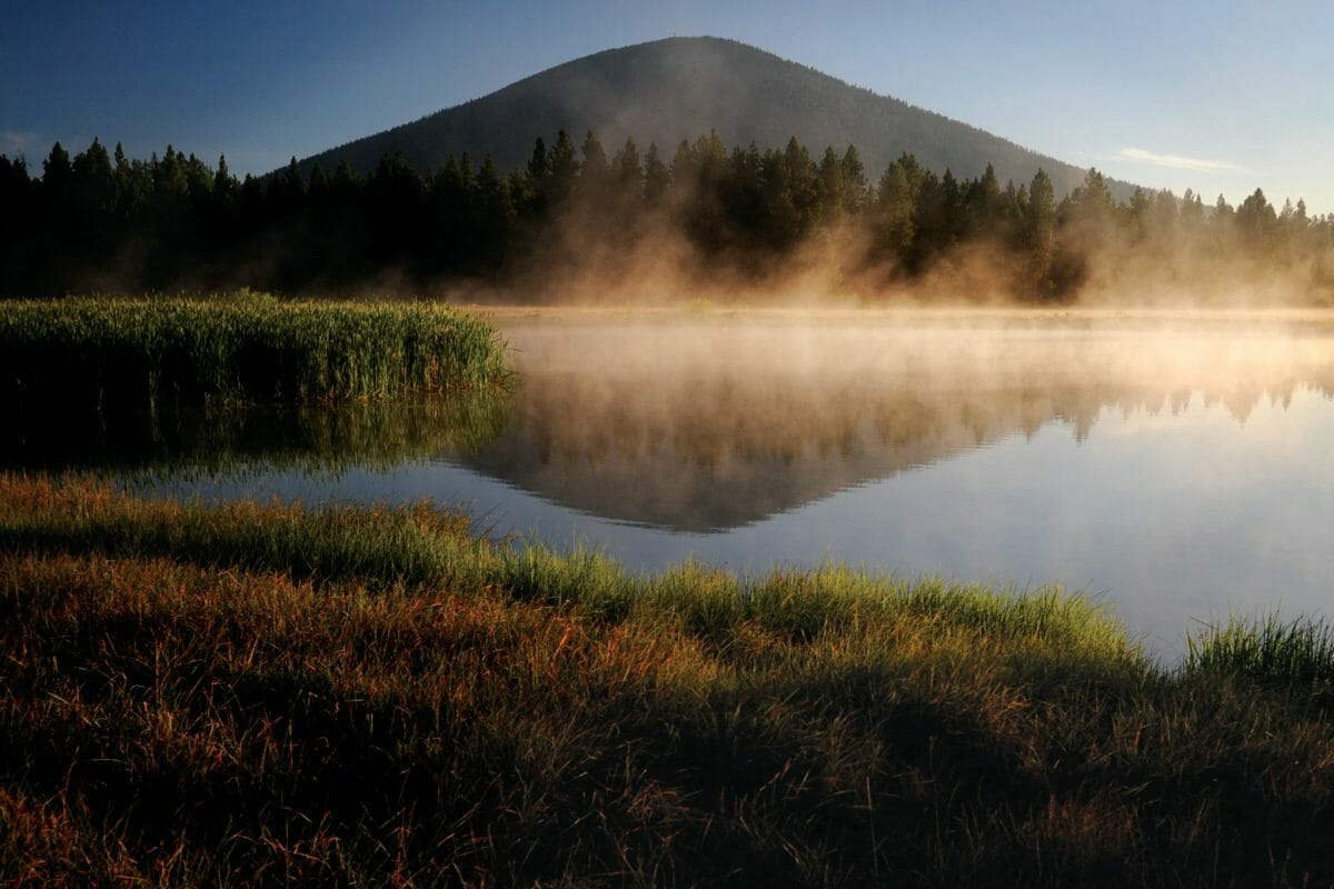 Image of the black butte from across a lake,Black Butte Ranch, Oregon, USA