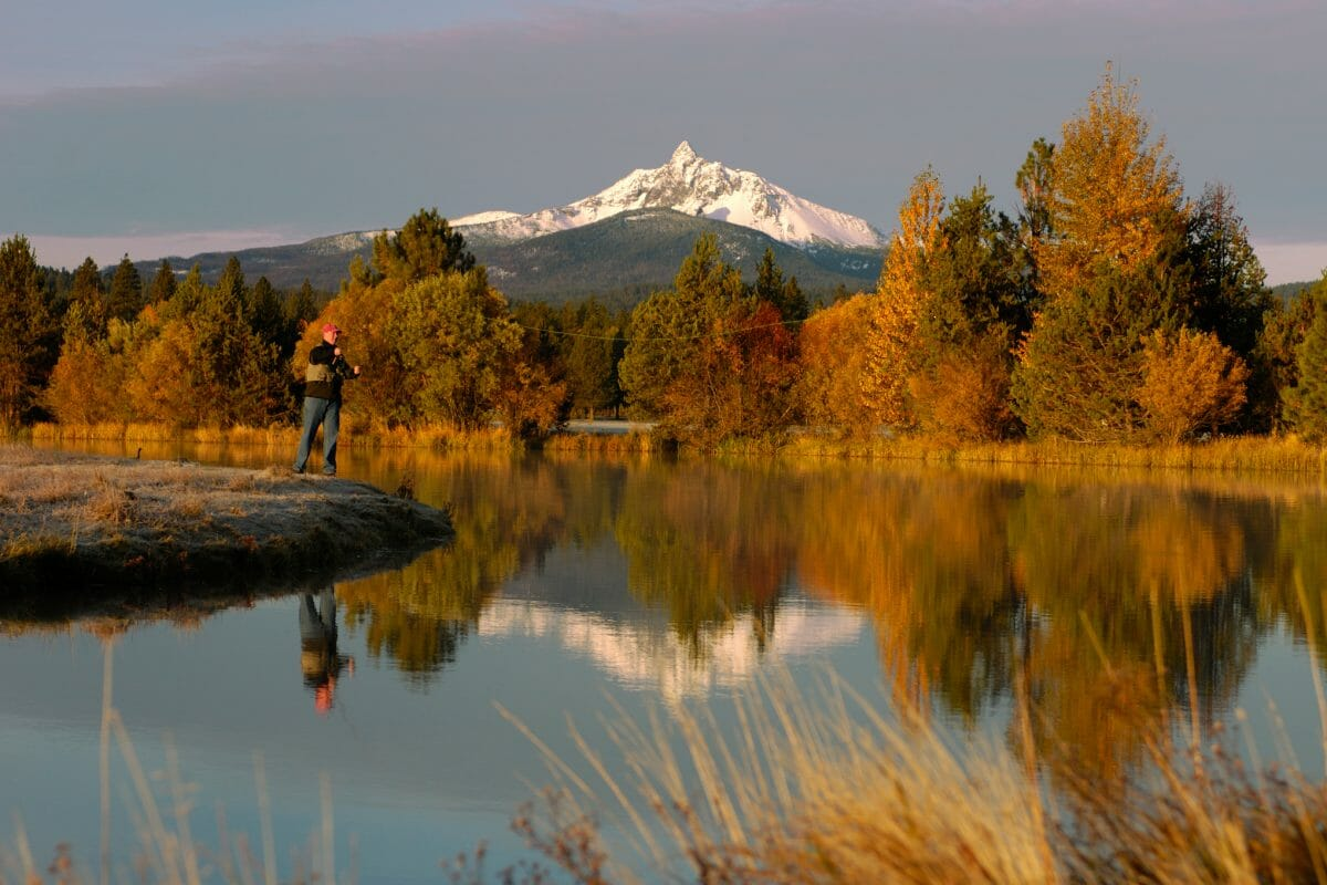 Image depicting a man fly fishing at Black Butte Ranch, Oregon, USA