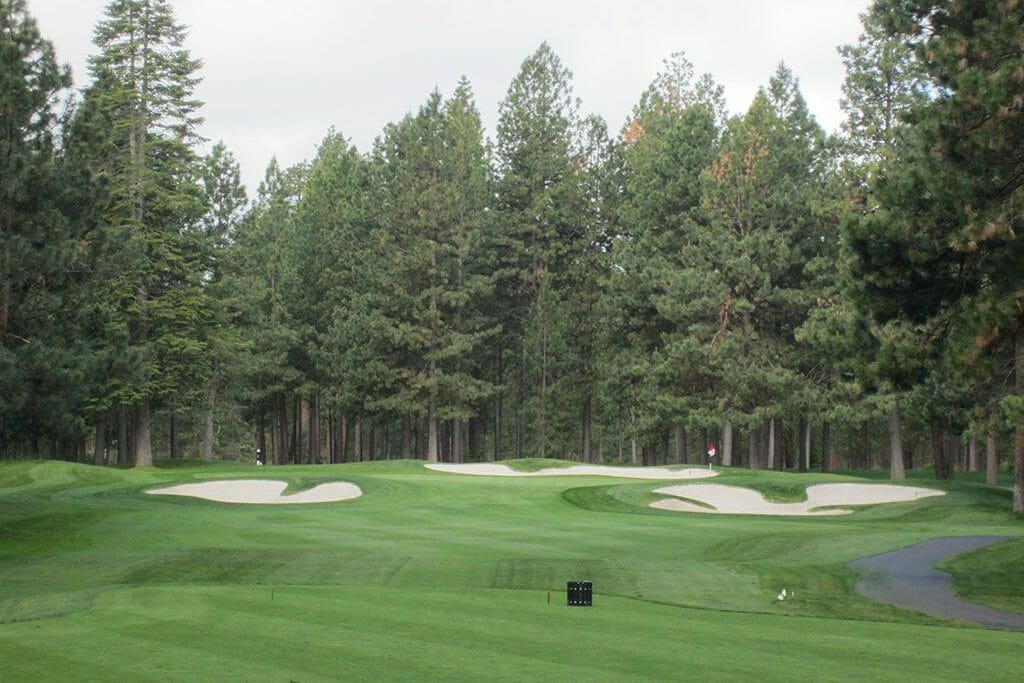 Image of the 4th hole and surrounding forest on the Big Meadow Golf Course, Black Butte Ranch, Oregon, USA