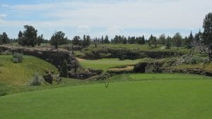 Looking at the signature hole par-3 8th on the Tom Fazio Golf Course at Pronghorn Resort, Bend, Oregon, USA