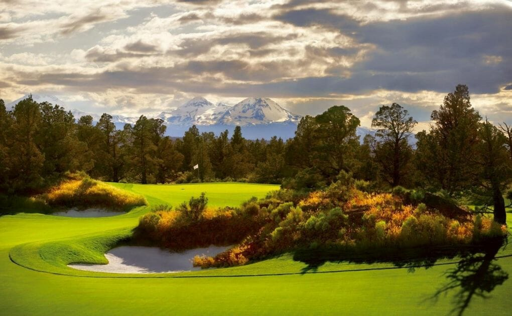Image of the 5th hole par-3 and distant mountain range on the Jack Nicklaus designed Signature Course at Pronghorn Resort, Bend, Oregon, USA