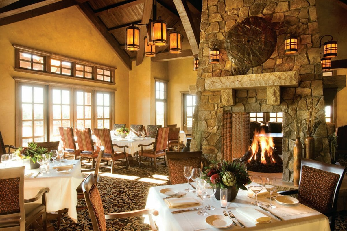 Inside a restaurant with fine dining and a wonderful fireplace,Pronghorn Golf Resort, Bend, Oregon, USA