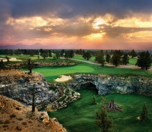 Image overlooking the par-3 8th hole on the Tom Fazio designed Championship golf course at Pronghorn Golf Resort, Bend, Oregon, USA