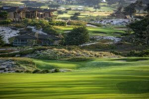 Depicting a house and green at Pebble Beach Spyglass Hill Golf Course