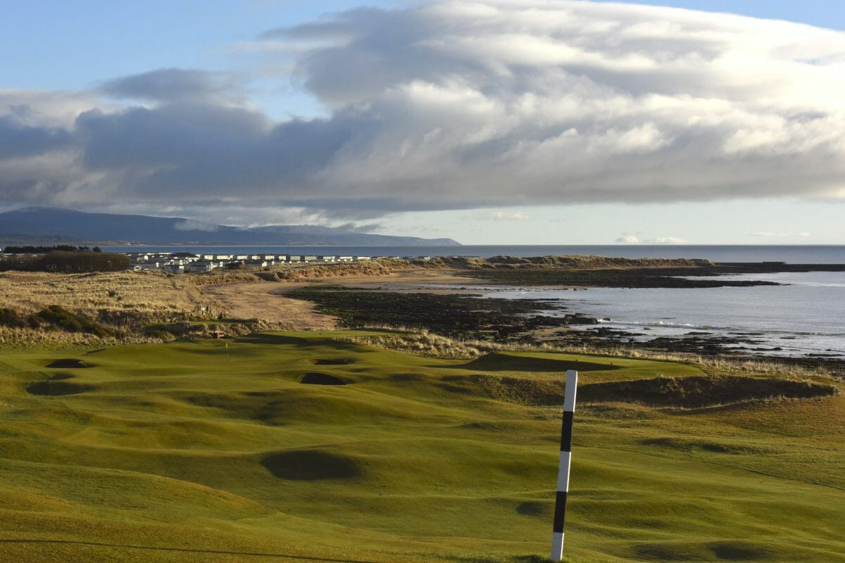 Image depicting the par-4 8th hole looking to the town of Dornoch and the sea at Royal Dornoch Golf Club, Scotland