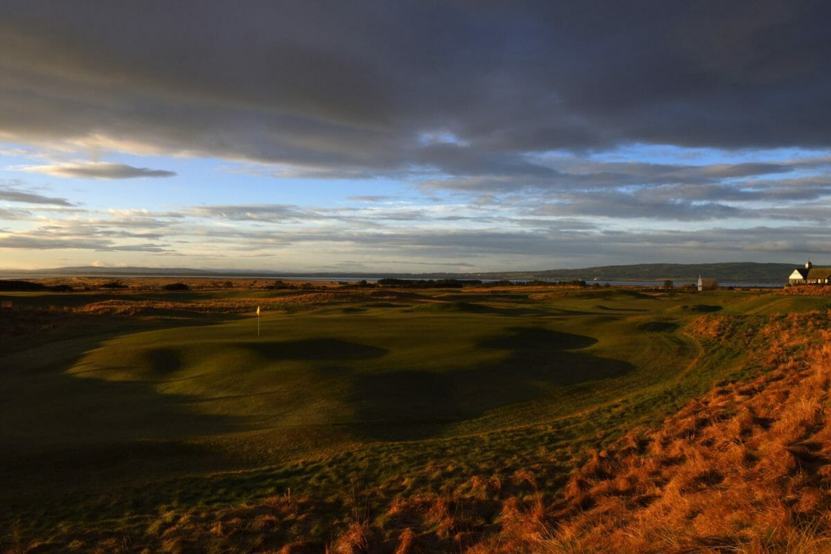 Image of a wintery sunrise over the par-4 1st hole at Royal Dornoch Golf Club, Scotland