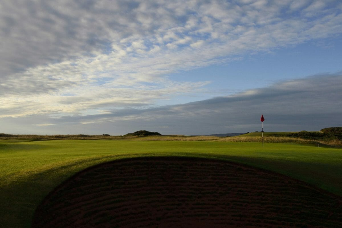 Image of the 15th green and cloudy sky at Royal Dornoch Golf Club, Scotland